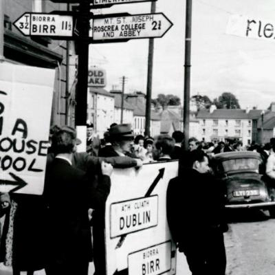 Small group near signpost at Tipperary Fleadh Cheoil Roscrea in 1964