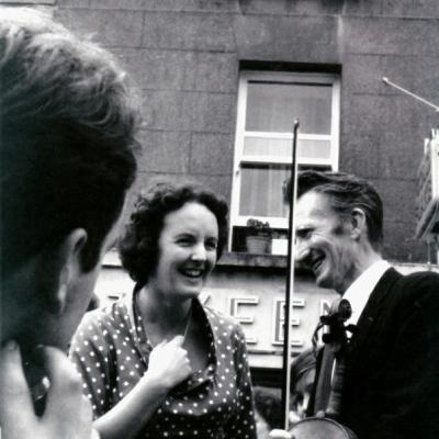 Ned Looby from Templetuohy with Mrs Chevasse at Fleadh Cheoil in 1964
